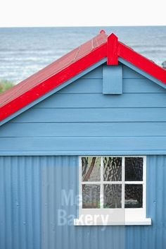 This is a Media Bakery licensable image titled 'Blue wooden fisherman's hut painted window shed' by artist Chris Walsh for editorial and commercial use only. No use with out payment. Search our large selection of royalty free and rights managed stock photos.