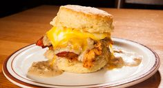 The Reggie Deluxe - Fried Chicken, Gravy, Bacon and Melted Cheese on a BISCUIT!