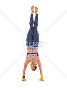female gymnast - Female gymnast doing stagged out hand stand