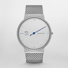 With a clean design and sophisticated details, our Ancher Mono is a timekeeping innovation.  A single bold-colored hand marks the minutes in a white dial. Where you might expect the date is a unique hour window. The piece is finished with a durable heavy gauge steel mesh band.