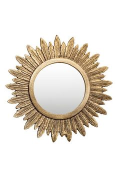 Round metal mirror: Round mirror in a metal frame in the shape of feathers with a hook at the back. Screws not included. Mirror diameter approx. 13.5 cm. Outer diameter approx. 28 cm.