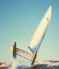 Hobie Cat 14 -- the iconic wave jumping photo, fun stuff until you keep going straight up and over backwards.