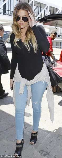 Khloe Kardashian displays slim pins as she jets out of LAX #dailymail