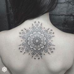Playful mandala tattoo on back by Alan