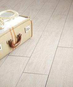 Arteak White.  Wood effect porcelain tile. Laid herringbone style. not stepped.