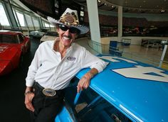 NASCAR legend Richard Petty portrait stands among the historic stock cars on display at the new NASCAR Hall of Fame, in Charlotte, NC May 5, 2010.
