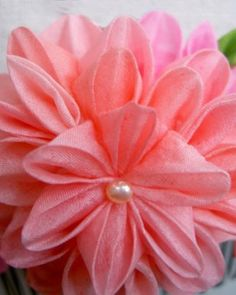 Silk flower comb, $25. Add a burst of color to your wedding-day ensemble by adorning your hair with one of these creative combs. Each contains a cluster of vibrant, origami-inspired silk blooms and pretty white pearls. It will fit right in with your sunny garden wedding, and the petals won't wilt in the steamy summer heat.