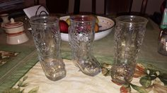 This is a really cool set of (3) western style cowboy glass boot mugs, circa 1980s. They are adorned in what I think are pheasants, or turkeys on both sides. These would absolutely be awesome items for the man cave. Definitely unique!!!))) They are in fine condition with no cracks, or chips. Please inspect listing photos, (zoom feature) to determine condition. Thank you so much for visiting, and dont forget to revisit soon..... Joao  Dimensions: H 6 x W 2-5/8 (top) x D (with handle) 3-3&...