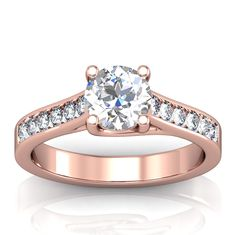 Rose gold trellis engagement ring with channel set diamonds    View all images on this style:  http://directengagementrings.com/rose-gold-engagement-rings/0-36ctw-rose-gold-trellis-engagement-ring-setting-design-19/