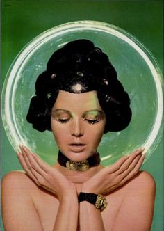 Space Age inspired fashion with a link to the space helmet that the astronauts wear and the idea of a futuristic theme.