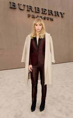 British model and Brit rhythm campaign star Suki Waterhouse wearing Burberry tailoring at the Prorsum Menswear A/W14 show space in London