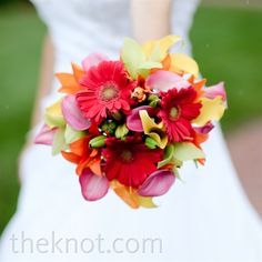 Bright red gerbera daises and colorful calla lilies made up Stefanie's bouquet.