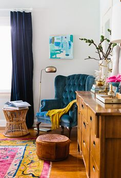 Reading nook inspiration for master; love the bright colored chair, midcentury piece and white walls