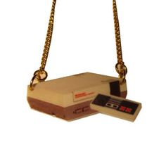 Awesome for all and especially classic gamers, for anyone who remembers the original Nintendo games console, here it is in pendant form! Printed on 3mm acrylic and laser cut, on a 41cm split goldplated curb chain. Retro cool! Measures approximately 40mm x 25mm (at widest points). Nickel and lead free.