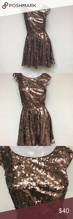 bebe Gold sequin dress size small Bebe nwt gold sequin dress. Size small lining has a few issues like it laid against velcro but not noticeable when worn. bebe Dresses