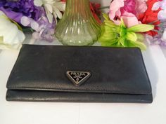 """Vintage Black Leather PRADA Wallet. The Wallet Measures 7 & 3/8ths"""" Long and 3 inches Wide. Zipper compartment and Credit cards too. www.CCCsVintageJewelry.com Priced at $200.00. Best, Coco"""