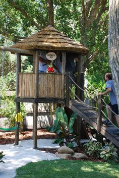 pics of landscaped backyards with kid play sets   tropical outdoor playsets by AMAZULU INC