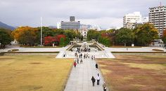 Hiroshima : Peace Memorial Park  Hiroshima's Peace Memorial Park (平和記念公園, Heiwa Kinen Kōen) is one of the most prominent features of the city. Even visitors not looking for it will likely stumble upon the large park of over 120,000 square meters. Its trees, lawns, and walking paths are in stark contrast to the surrounding downtown area.  Before the bomb, the area of what is now the Peace Park was the political and commercial heart of the city. For this reason, it was chosen as the pilot's…