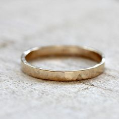 14k solid yellow gold hammered ring from praxis jewelry