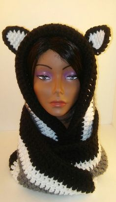 Cute and warm go together in this hooded infinity scarf/cowl with animal ears.  Made with Bernat soft, chunky yarn, this scarf/cowl is thick and warm.  Will help ward off the winter chills and wind.  Slip the hood over your head and wrap the scarf around your neck for added warmth.  Can be worn over or under your coat.  I just love his scarf.  It's really warm and soft.  The colors complement each other perfectly.       Want this in a different color?  Message me with your custom order…