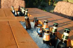Patio Table with Built-in Beer/Wine Coolers.   LOVE this... going to make with one small 'addition'. Will post pics when completed. Thank you for the inspiration Ana White.