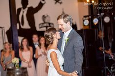 bride and groom, dancing, wedding reception, first dance, romantic, happy in love, fun wedding venue, wedding photography :: Ashley + Dan's Wedding at Monday Night Brewing in Atlanta, GA :: with Krista