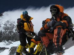 Giles (left) with a Top Out mask and a modern regulator capable of delivering up to 6 litres of oxygen per minute as opposed to the Climbing Sherpa from another team on the right with an old Poisk system. Mountain Wear, Big Mountain, South Col, Everest Mountain, Monte Everest, Down Suit, Boiler Suit, Special Person, Mountaineering