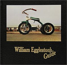 """""""William Eggleston's Guide"""" was the first one-man show of color photographs ever presented at The Museum of Modern Art, New York, and the Museum's first publication of color photography. The reception was divided and passionate. The book and show unabashedly forced the art world to deal with color photography, a medium scarcely taken seriously at the time, and with the vernacular content of a body of photographs that could have been but definitely weren't some average American's…"""