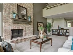 Beautiful brick fireplace with mantel. 12843 Topping Manor, Town and Country, MO 63131