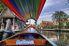 View from a longtail boat on one of the many canals of the Chao Phraya River in Bangkok, Thailand.