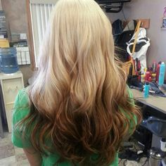 Love this reverse ombre. Blonde to warm brown. Styled with lose waves.
