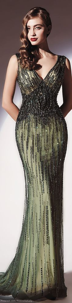 This is a very heavily beaded couture evening gown that can be easily replicated in any color, size or with changes by our company. Contact us for details.