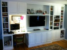 I would like a built in on the exterior wall with desk/office section and a tv section with storage in between.