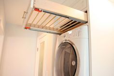 Pull out drying rack over stacked washer/dryer