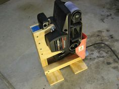 Belt sander stand    http://www.instructables.com/id/Belt-Sander-Stand/
