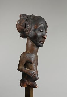 Commemorative figure Buli Master, possibly Ngongo ya Chintu (Hemba, ca. 1810-1870) Date: 19th century Geography: Democratic Republic of the Congo Culture: Hemba peoples Medium: Wood Dimensions: H. x W. x D.: 12 x 4 x 4 1/2 in. (30.5 x 10.2 x 11.4 cm) Classification: Wood-Sculpture Credit Line: Private collection