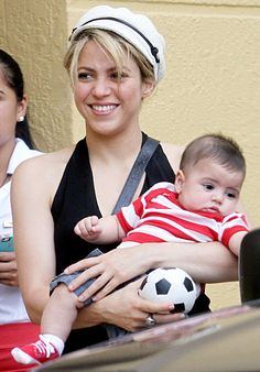 Soccer Wife 'n Kid Shakira held baby boy Milan as her beau and Milan's dad, soccer star Gerard Pique, arrived for training in Miami June 6.