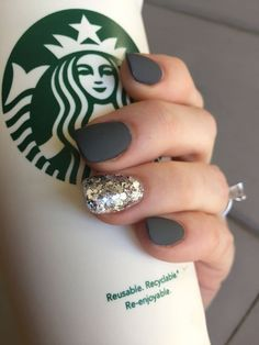 Matte gray nails with a dash of glitter and a beautiful engagement ring