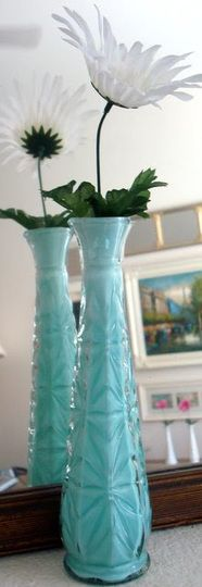 glass vase makeover: pour Robin's egg blue  INSIDE the vase instead of painting the outside so it retains the shine of glass but now has color
