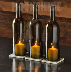 This is a 3 piece candle centerpiece made from recycled bottles. They rest on 3.5 square tiles made of hand painted glass. The glass tile