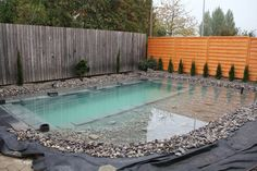 a guy did a diy swimming pond in his backyard. awesome look, diy, and in a small backyard. Great inspiration!