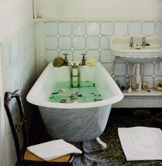 My bathtub is in my kitchen - so for the next party I'm putting flowers in the tub