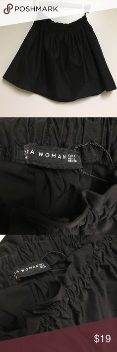 Zara Woman black stretch waist skirt. Never worn black skirt. Super comfortable for an easy dressed up outfit. Just enough volume for a black mini skirt. Cute with a rope tucked in and a statement necklace. Waist is eslastic that's hidden by the gathered look as seen in picture. Easy to pull on and over a top. Zara Skirts Mini