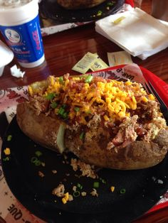 Lunch at Full Moon barbecue I made 4 meals out of this loaded baked potato in Birmingham Alabama July 2014
