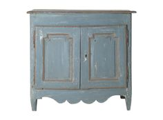 This distressed, antique cabinet has such a relaxed feel while the lines keep it from fading into a wall. Its blue and gray tones remind me of weathered pier on the water. (jasonhomeanddesign.com)
