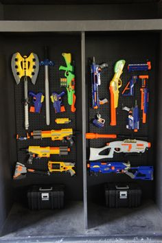 Nerf arsenal setup we just created from peg boards. Every Sunday is a Nerf party at crossover! Definitely the coolest Nerf gun storage ever.   Usually you can get a pack of brackets for a peg board that comes with back spacers and assorted hooks. The tool box is a husky brand tackle/tool box we got from @homedepot on sale for around $5 a peice. The total project not including the cost of nerf guns (peg boards, hooks, boxes, black spray paint) was about $35.
