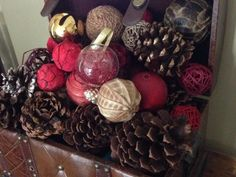 HGTVGardens community member  Julia  styled pinecones with decorative ornaments to bring the outdoors inside.