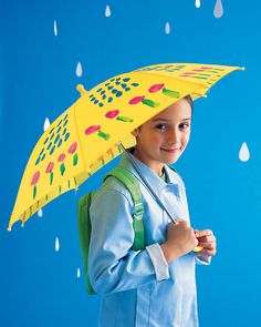 On rainy days, let your children play Picasso by painting a fanciful pattern on a child-size umbrella.