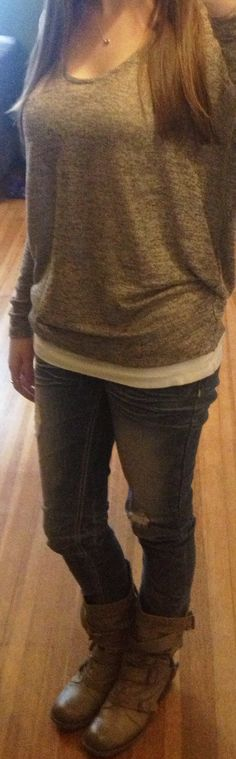 Destroyed skinny jeans, dolman sweater, grey/tan buckle boots, mini Tiffany bean necklace.