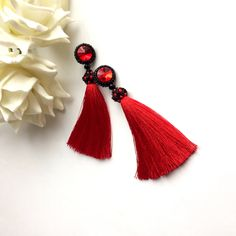 A personal favorite from my Etsy shop https://www.etsy.com/listing/555995645/red-black-beaded-tassel-earrings-long